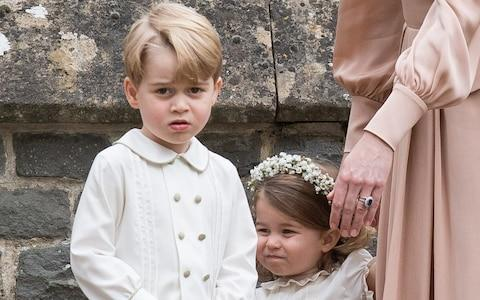 Prince George and Princess Charlotte at Pippa Middleton's wedding - Credit: Samir Hussein