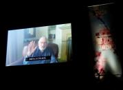 A video message by actor and director Robert De Niro is screened during the opening ceremony at 33rd Tokyo International Film Festival, amid the coronavirus disease (COVID-19) outbreak, in Tokyo
