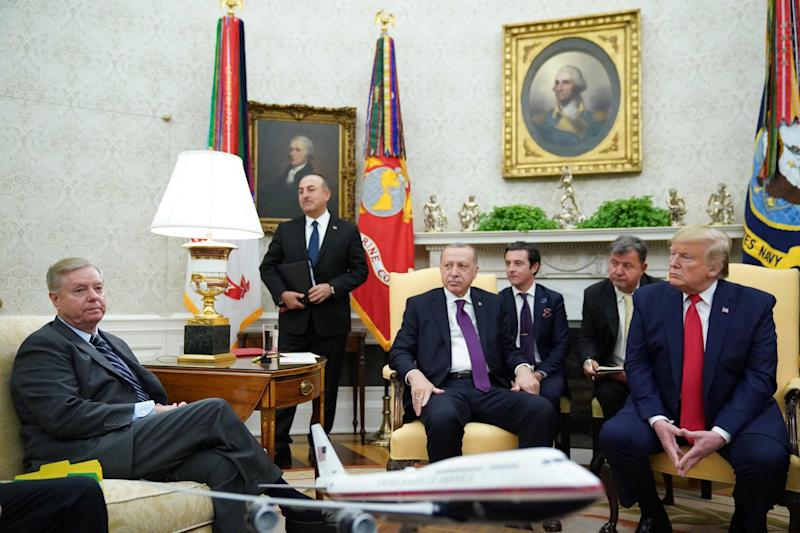 South Carolina Republican senator Lindsey Graham, left, with Turkish president Recep Tayyip Erdogan, centre, and US president Donald Trump, right, in the Oval Office on 13 November, 2019: AFP via Getty Images