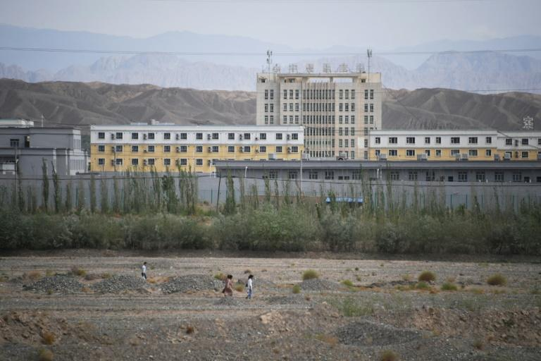 Authorities in China's Xinjiang region have rounded up an estimated one million mostly Muslim Turkic-speaking minorities into internment camps (AFP Photo/GREG BAKER)