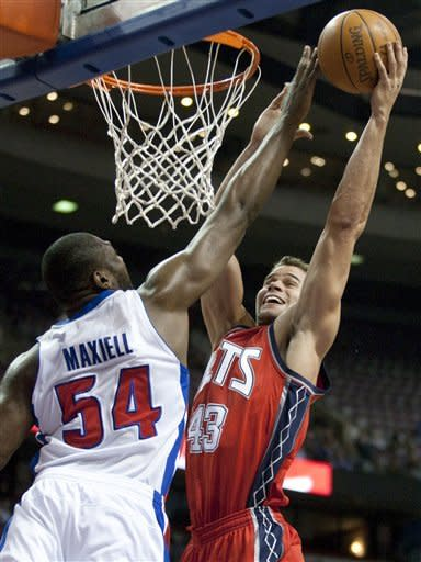 Detroit Pistons' Jason Maxiell (54) blocks a shot by New Jersey Nets' Kris Humphries (43) during the first half of an NBA basketball game on Friday, Feb. 10, 2012, in Auburn Hills, Mich. (AP Photo/Duane Burleson)