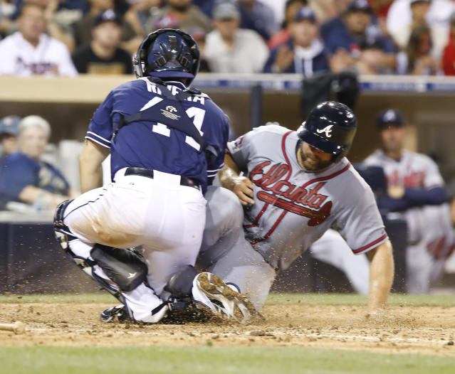 San Diego Padres catcher Rene Rivera makes the out at home on Atlanta Braves's Evan Grattis during the eighth inning of a baseball game Saturday, Aug. 2, 2014, in San Diego. (AP Photo/Don Boomer)