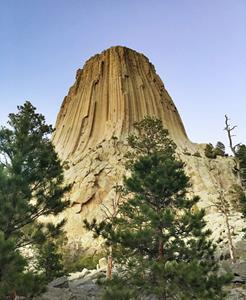 A scenic 3-hour drive from Casper, find Devils Tower, an ancient laccolith that rises high into Wyoming's open sky.