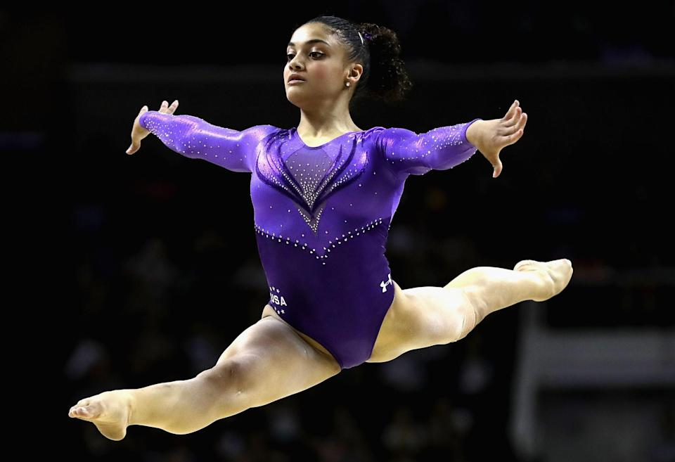 <p>Her signature floor exercises and beam routines earn top scores due to her personality and confidence. Her favorite training music? EDM or rap. (Getty) </p>