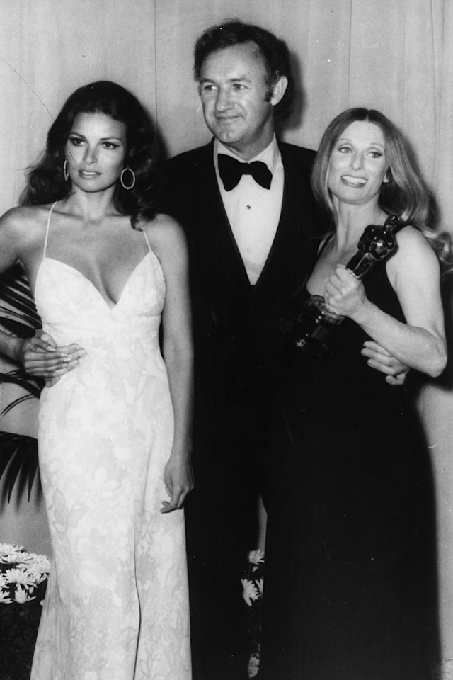 <p>In the '70s it didn't get much sexier than Raquel Welch in a spaghetti strap halter gown and hoops.</p>