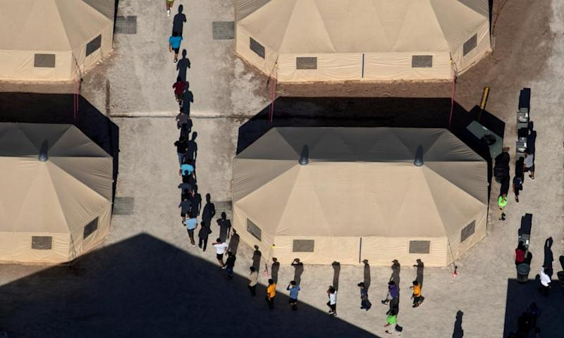 Immigrant children are led by staff in single file between tents at a detention facility in Tornillo, Texas<br>Immigrant children are led by staff in single file between tents at a detention facility next to the Mexican border in Tornillo, Texas, U.S., June 18, 2018. Picture taken June 18, 2018 REUTERS/Mike Blake TPX IMAGES OF THE DAY