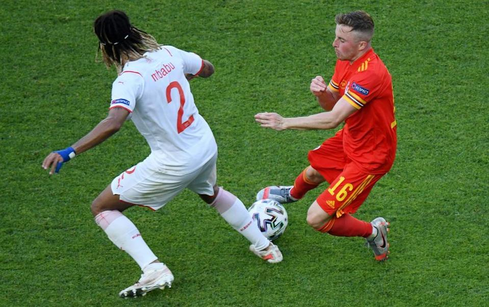 Joe Morrell battles for possession with Switzerland's Kevin Mbabu.