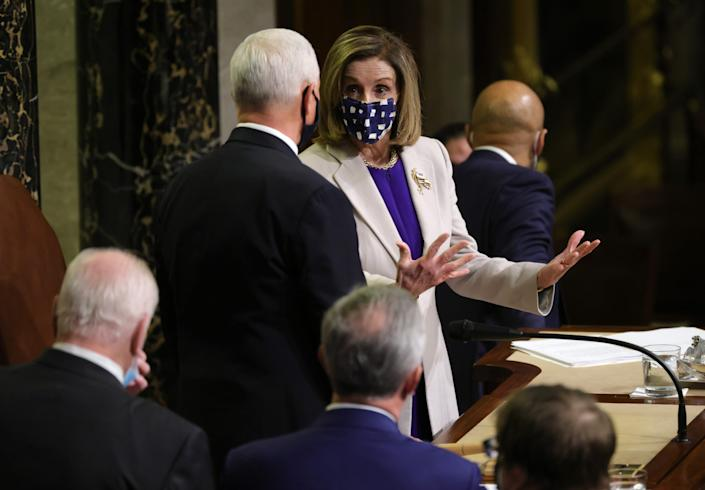 U.S. Speaker of the House Nancy Pelosi (R) (D-CA) talks with Vice President Mike Pence during the joint session of Congress on January 07, 2021 in Washington, DC. Lawmakers affirmed President-elect Joe Biden's win.
