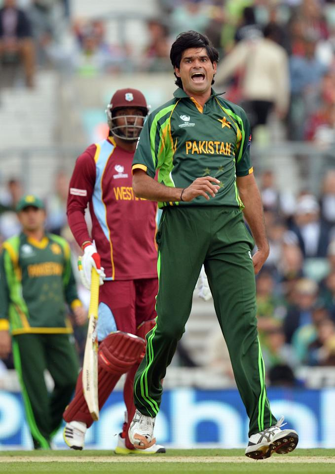 Pakistan's Mohammad Irfan celebrates taking the wicket of West Indies' Johnson Charles (not pictured) during the ICC Champions Trophy match at The Oval, London.