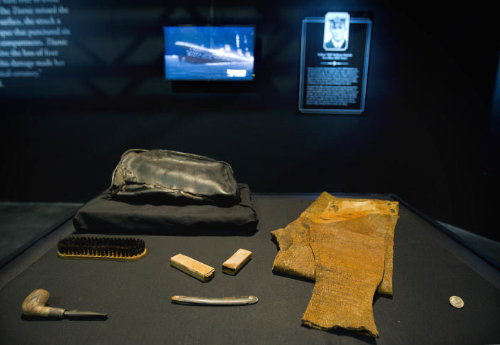 """The personal effects of William Murdoch, the bridge officer aboard the Titanic, sit on display before an exhibition opens to the public Tuesday, April 3, 2012, in Atlanta. From the pitch-black depths 2½ miles beneath the North Atlantic, salvagers of the Titanic made a notable discovery when they located the personal effects of Murdoch, the bridge officer who tried in vain to keep the doomed ship from colliding with an iceberg. The artifacts, including a shoe brush, straight razor and pipe, are the first to be specifically to Murdoch, a central figure in the disaster who gained added notoriety after James Cameron's polemical portrayal of him in the 1997 blockbuster movie """"Titanic."""" (AP Photo/David Goldman)"""