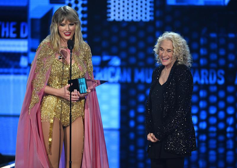Taylor Swift, left, accepts the award for artist of the decade from Carole King at the American Music Awards on Sunday, Nov. 24, 2019, at the Microsoft Theater in Los Angeles. (Photo: Chris Pizzello/Invision/AP)