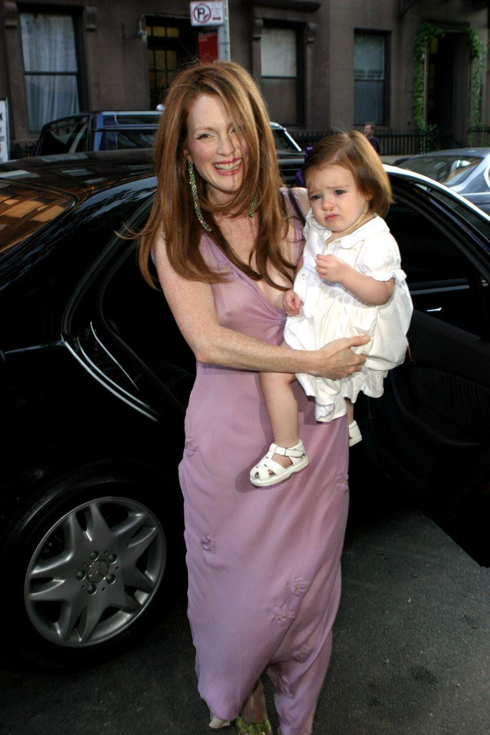 <p>For her wedding to director Bart Freundlich, Julianne Moore wore a embroidered lilac slip dress by Prada which she paired with complimenting emerald green accessories. Tres chic! </p>