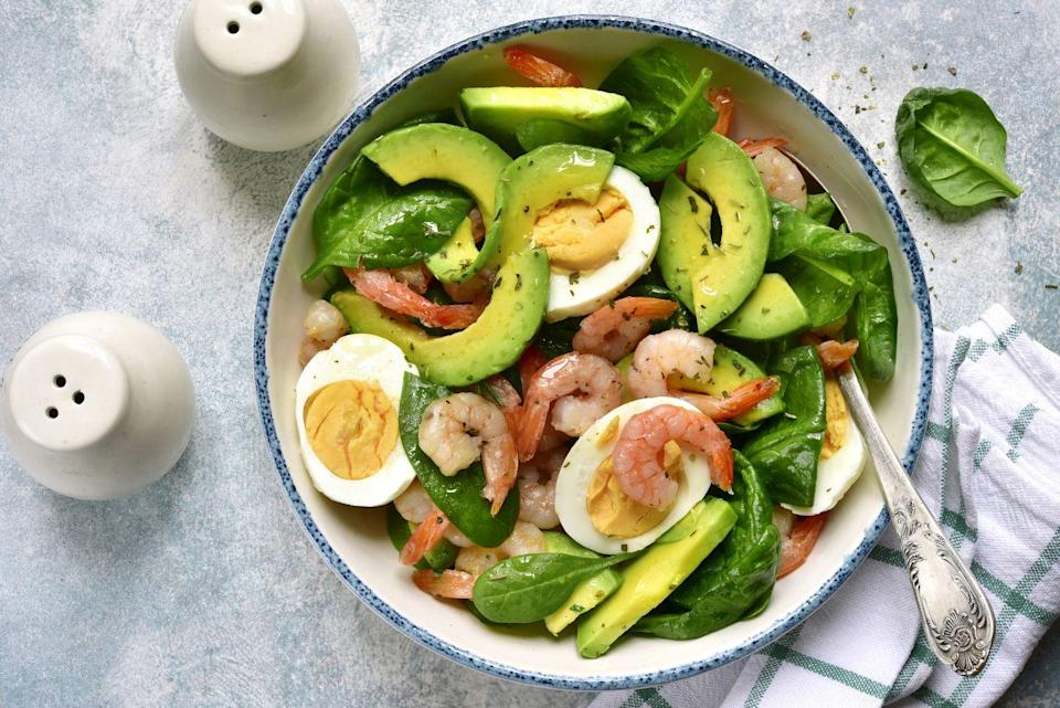 """<p>While you can't go too crazy on the tomatoes, this is a beautifully balanced salad to begin with. If you're already eating protein for your entrée, try skipping the shrimp here. </p><p><a href=""""https://www.prevention.com/food-nutrition/recipes/a26986140/shrimp-avocado-and-egg-chopped-salad-recipe/"""" rel=""""nofollow noopener"""" target=""""_blank"""" data-ylk=""""slk:Get the recipe from Prevention »"""" class=""""link rapid-noclick-resp""""><em>Get the recipe from Prevention »</em></a></p>"""