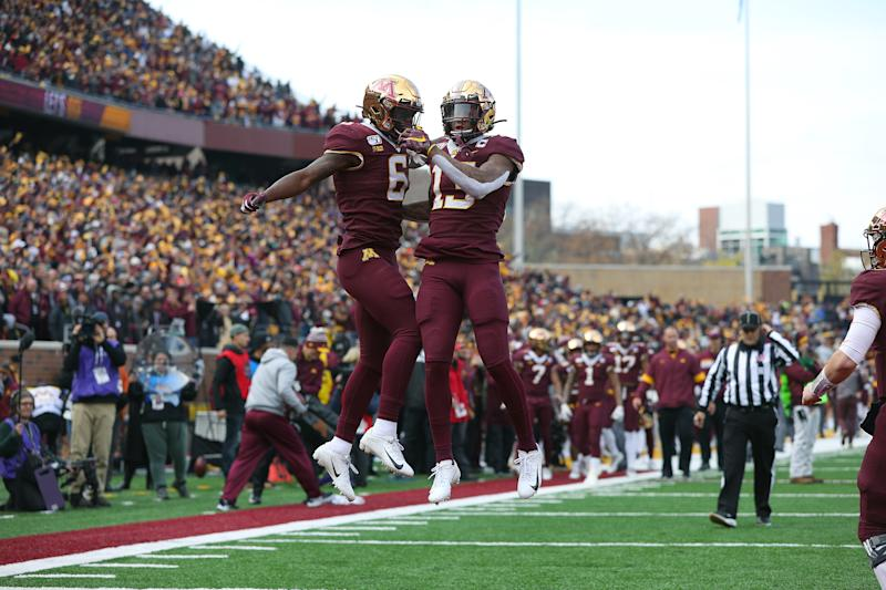 MINNEAPOLIS, MN - NOVEMBER 09: Rashod Bateman #13 of the Minnesota Golden Gophers celebrates his touchdown with Tyler Johnson #6 of the against the Penn State Nittany Lions in the first quarter at TCFBank Stadium on November 9, 2019 in Minneapolis, Minnesota. (Photo by Adam Bettcher/Getty Images)