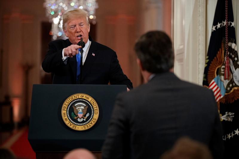 President Donald Trump faces off with CNN's Jim Acosta during a White House news conference in 2018.