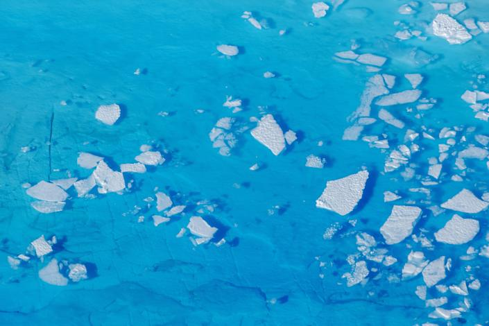 FILE PHOTO: Chunks of ice float inside of meltwater pools on top of the Helheim glacier near Tasiilaq, Greenland, June 19, 2018. REUTERS/Lucas Jackson/File Photo