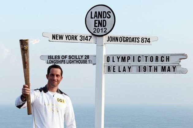 Olympic gold medal sailor and the first London 2012 torchbearer, Ben Ainslie poses for a photograph beside the Lands End sign on May 19, 2012 in Cornwall, England. The Olympic Flame arrived in the UK yesterday and now begins a 70-day relay involving 8,000 torchbearers covering 8,000 miles.(Photo by Matt Cardy/Getty Images)