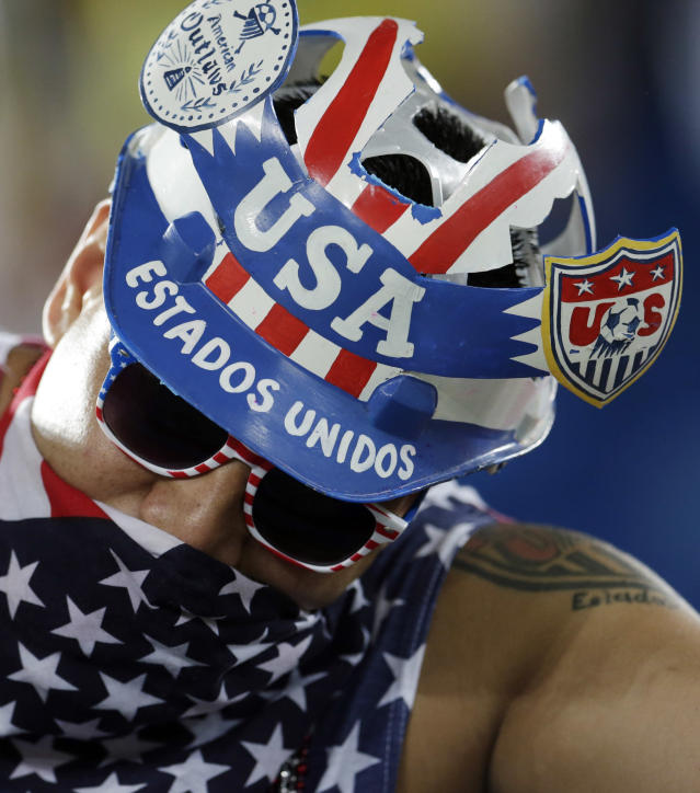 An American fan shows off his headwear before the group G World Cup soccer match between Ghana and the United States at the Arena das Dunas in Natal, Brazil, Monday, June 16, 2014. (AP Photo/Petr David Josek)