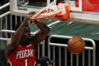 New Orleans Pelicans' Zion Williamson dunks during the second half of an NBA basketball game against the Milwaukee Bucks Thursday, Feb. 25, 2021, in Milwaukee. (AP Photo/Morry Gash)