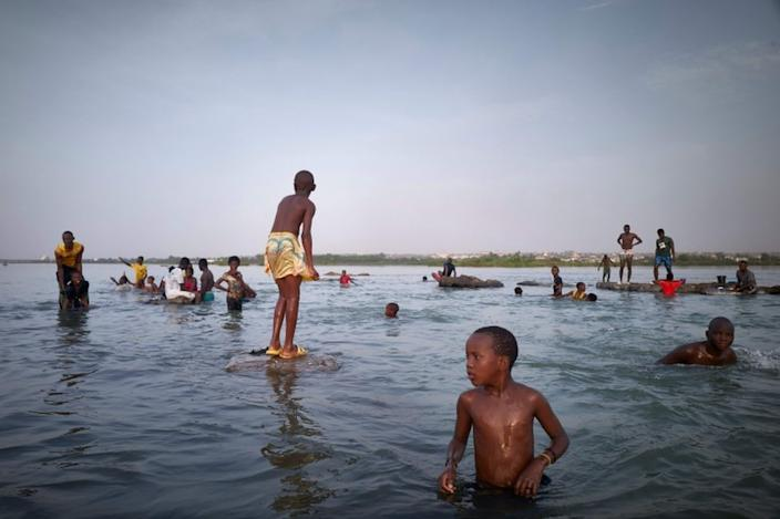 And on Friday, bathers in Mali cool off in the Niger River, which flows through several West African countries and is the third largest river on the continent.