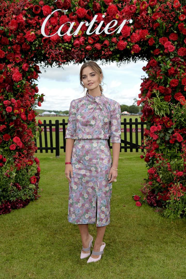Demonstrating how to work summer florals, Jenna Coleman chose a chic Erdem co-ord for a day at the polo paired with the Malone Souliers 'Mara' pump. <em>[Photo: Getty]</em>