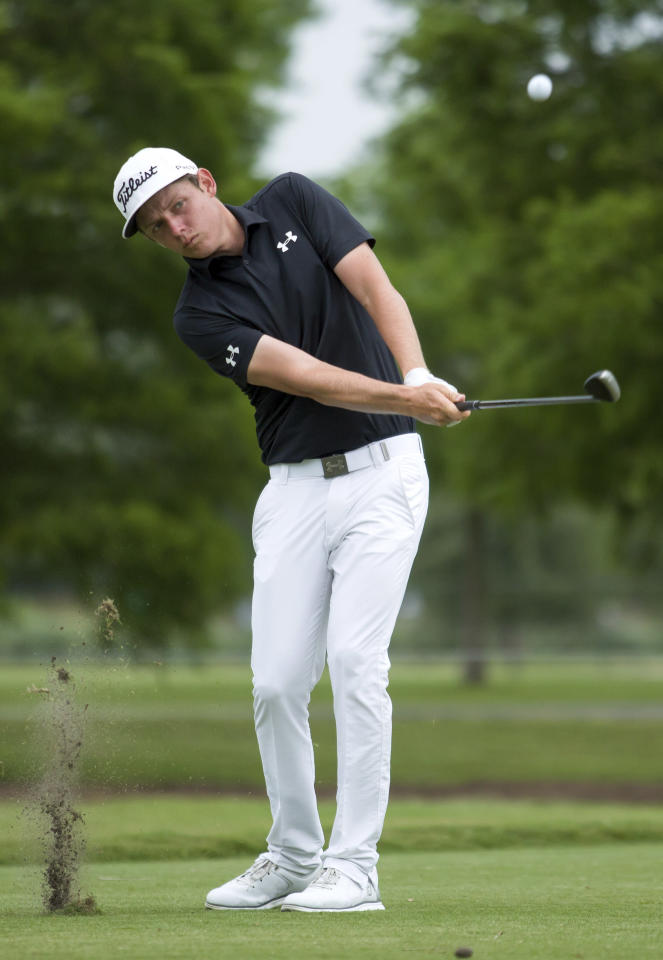 Cameron Smith, of Brisbane, Australia, chips to the second green during the final round of the PGA Zurich Classic golf tournament's new two-man team format at TPC Louisiana in Avondale, La., Sunday, April 30, 2017. (AP Photo/Scott Threlkeld)