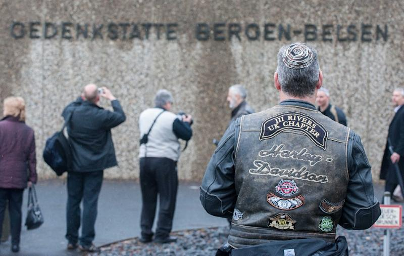 A member of a British Motorcycle group wearing a kippa pays respect at a memorial dedicated to victims of the former Nazi concentration camp on April 26, 2015 at Bergen-Belsen (AFP Photo/Hauke-Christian Dittrich)