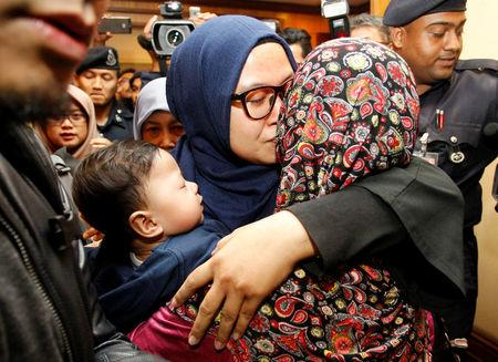 Saadah Jamaludin, one of the nine Malaysians who were previously stranded in Pyongyang hugs a family member as she returns home from Pyongyang, at the Kuala Lumpur International Airport in Sepang, Malaysia March 31, 2017. REUTERS/Lai Seng Sin