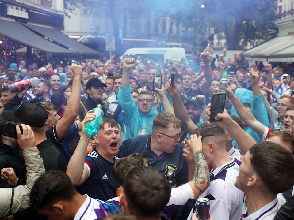 Scotland fans gather in Leicester Square shortly before kick off (PA)