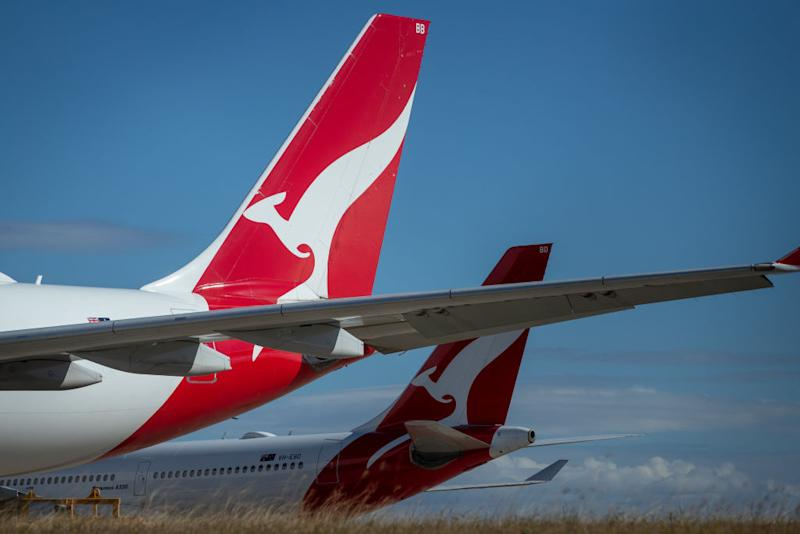 The Qantas Airways Ltd. logo is displayed on the tails of aircraft standing at Brisbane Airport in Brisbane, Australia, on Tuesday, June 9, 2020.