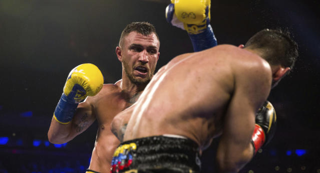 Vasiliy Lomachenko (L) throws a punch at Jorge Linares during the WBA lightweight championship boxing match Saturday, May 12, 2018, in New York. (AP Photo)
