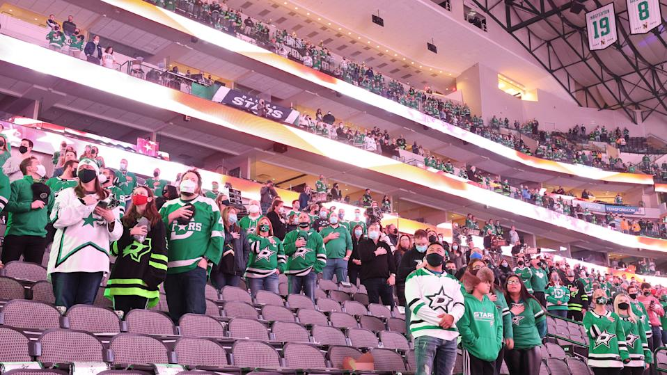 DALLAS, TEXAS - JANUARY 22:  NHL fans during the national anthem before a game between the Nashville Predators and the Dallas Stars at American Airlines Center on January 22, 2021 in Dallas, Texas. (Photo by Ronald Martinez/Getty Images)