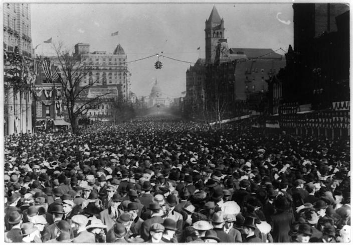 In this photo provided by the Library of Congress, taken in 1913, shows parade and enormous crowd on Pennsylvania Ave. looking toward Capitol past old Post Office, in Washington. Thousands of women take to the streets of Washington, demanding a greater voice for women in American political life as a new president takes power. This will happen on Saturday, Jan. 21, 2017, one day after the inauguration of Donald Trump. This DID happen more than 100 years ago, one day before the inauguration of Woodrow Wilson. (Library of Congress via AP)