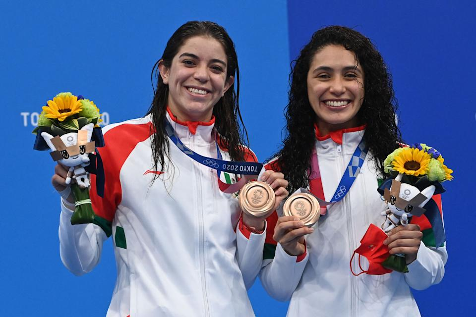 Bronze medallists Mexico's Alejandra Orozco Loza (L) and Mexico's Gabriela Agundez Garcia pose on the podium after the women's synchronised 10m platform diving final event during the Tokyo 2020 Olympic Games at the Tokyo Aquatics Centre in Tokyo on July 27, 2021. (Photo by Attila KISBENEDEK / AFP) (Photo by ATTILA KISBENEDEK/AFP via Getty Images)