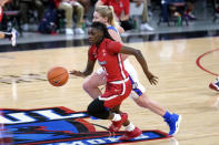 St. John's guard Unique Drake (1) drives against DePaul guard Lexi Held during the first half of an NCAA college basketball game in Chicago, Wednesday, Jan. 13, 2021. (AP Photo/Nam Y. Huh)
