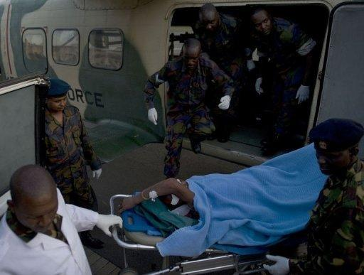 A policeman wounded in one of the attacks on churches in the Kenyan town of Garissa, near the border with Somalia, is off-loaded from an air-ambulance by paramedics. Gunmen killed 17 people and wounded dozens in gun and grenade attacks on two churches Sunday in the Kenyan town of Garissa near the border with Somalia, officials said