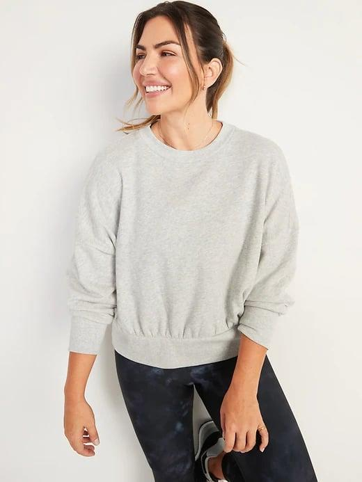 """<p>We bet you'll wear this <span>Old Navy Loose Crew-Neck Cropped Sweatshirt</span> ($18-$24, originally $35) more places than just workouts as it also looks great topping <a href=""""http://www.popsugar.com/fashion/best-high-waisted-jeans-from-old-navy-48515519"""" class=""""link rapid-noclick-resp"""" rel=""""nofollow noopener"""" target=""""_blank"""" data-ylk=""""slk:your favorite jeans"""">your favorite jeans</a>.</p>"""