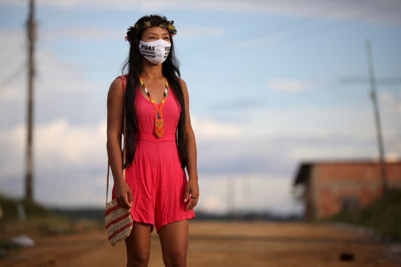 The Wider Image: In the Amazon, an indigenous nurse volunteers in coronavirus fight