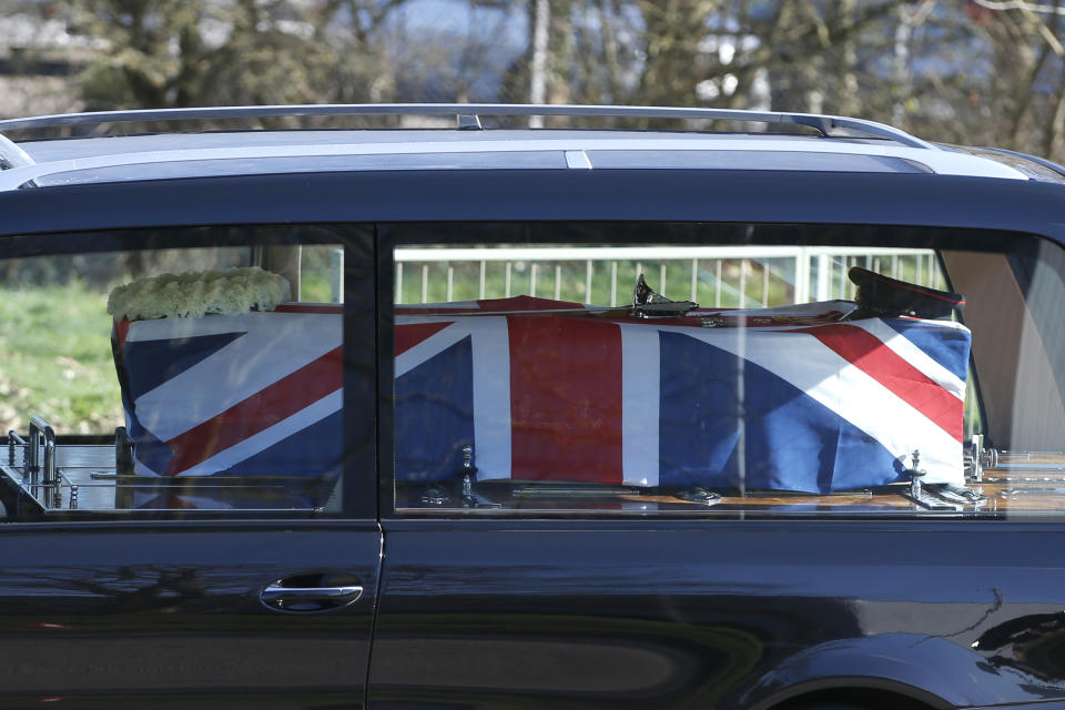 BEDFORD, ENGLAND - FEBRUARY 27: The funeral procession for Sir Tom Moore passes through Bedford on the way to Bedford Crematorium ahead of a private ceremony on February 27, 2021 in Bedford, England. WWII veteran, Sir Tom raised nearly £33 million for NHS charities ahead of his 100th birthday last year by walking laps of his garden in Marston Moretaine, Bedfordshire. He died on the 2nd of February after testing positive for COVID-19. (Photo by Hollie Adams/Getty Images)