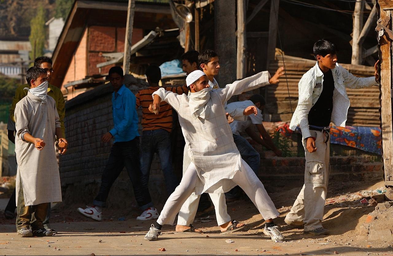 SRINAGAR, INDIA - OCTOBER 3 : Kashmiri rock throwing protesters attack Indian paramilitary as tensions on the streets erupt after Friday prayers October 3, 2008 in Srinagar, Kashmir, India. Kashmiri people have been protesting against Indian rule claiming that they are alienated from the Indian state and want a platform for autonomy. The region is planning a major protest on October 6, 2008. Today's street battles come on the third day of Eid- Al-Fitr, a three day holiday signaling the end of Ramadan, Islam's holiest month.  (Photo by Paula Bronstein/Getty Images)