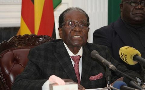 Zimbabwean President Robert Mugabe delivers his speech during a live broadcast at State House in Harare, Sunday, Nov, 19, 2017 - Credit: AP
