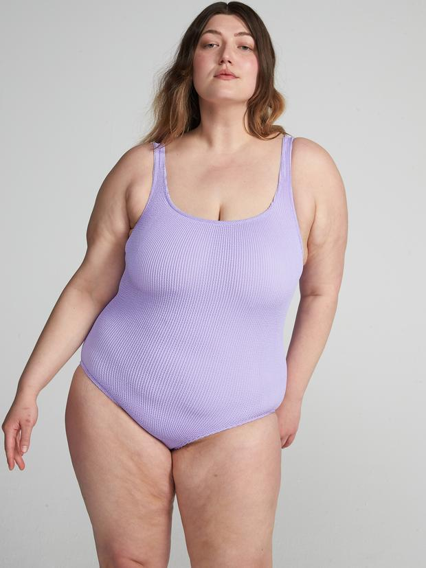 """<strong><h4>YouSwim</h4></strong><br><strong>Size range</strong><br>UK6 - UK18<br><br>YouSwim's designs are made from a ribbed and seamless material that stretches to fit seven sizes in one, adapting to your body as it changes – through periods, pregnancies, bloating and more.<br><br><strong>Youswim</strong> Aplomb One-Piece In Aster, $, available at <a href=""""https://www.youswim.com/collections/all/products/aplomb-one-piece?variant=32030853038129"""" rel=""""nofollow noopener"""" target=""""_blank"""" data-ylk=""""slk:Youswim"""" class=""""link rapid-noclick-resp"""">Youswim</a>"""