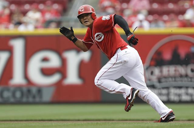 In this Aug. 7, 2013, file photo, Cincinnati Reds' Shin-Soo Choo runs to second base in the first inning of a baseball game against the Oakland Athleticsin Cincinnati. The Rangers have made another Texas-sized deal to improve their offense. Free agent outfielder Choo agreed to a $130 million, seven-year contract with the Rangers, a person familiar with the deal told The Associated Press on Saturday, Dec. 21, 2013. (AP Photo/Al Behrman, File)