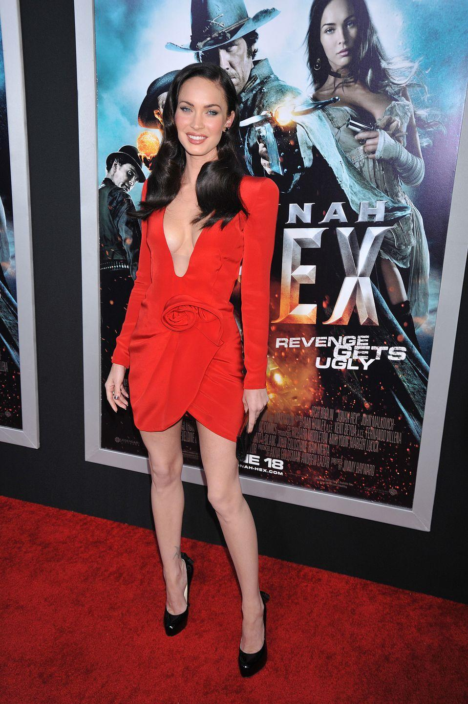 <p>Fox stole the show in a plungeneck red long-sleeved dress by Giorgio Armani Privé with black heels for the event. </p>