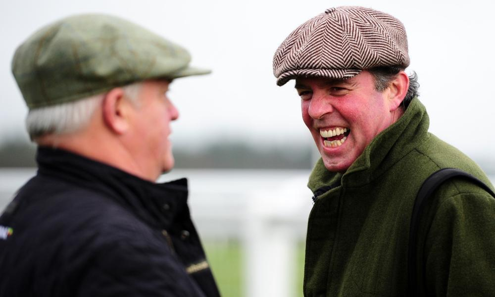 What's Happening's trainer Tom George (r) might have a chance of winning at Sandown.