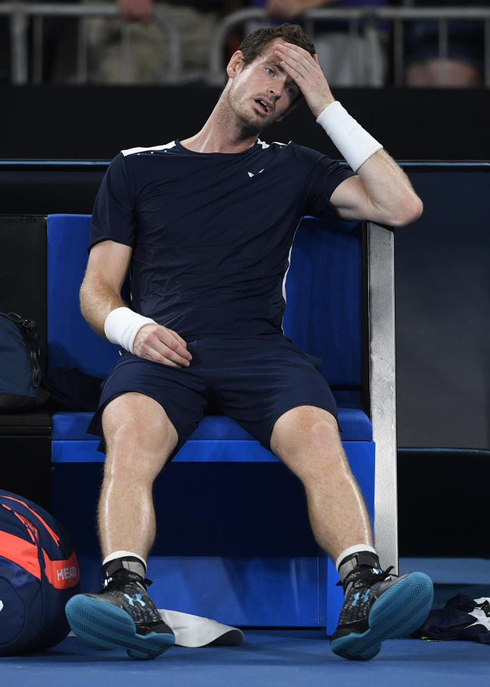 FILE - In this Monday, Jan. 14, 2019 file photo Britain's Andy Murray reacts after his first round loss to Spain's Roberto Bautista Agut at the Australian Open tennis championships in Melbourne, Australia. Former world number one Murray's participation at the upcoming Australian Open is in doubt after the Briton tested positive for COVID-19. (AP Photo/Andy Brownbill, File)