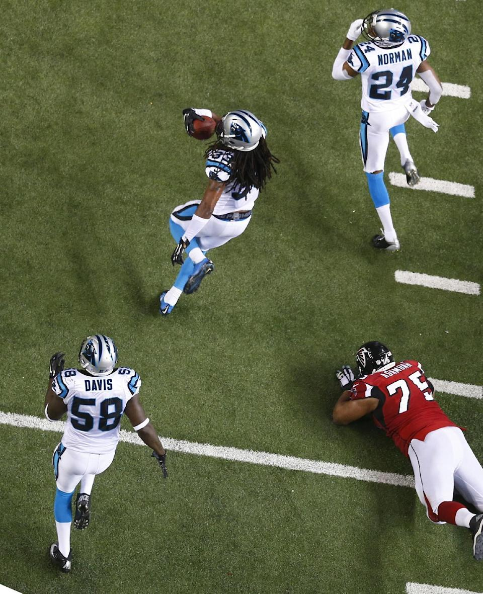Carolina Panthers free safety Tre Boston (33) runs back a intercepted ball against the Atlanta Falcons during the second half of an NFL football game, Sunday, Dec. 28, 2014, in Atlanta. Boston scored on the play. (AP Photo/John Bazemore)