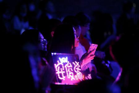 """Fans of China's all-girl """"boyband"""" FFC-Acrush follow their maiden press conference in Beijing, China April 28, 2017. REUTERS/Damir Sagolj"""