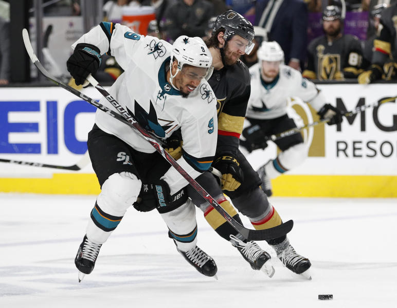 San Jose Sharks left wing Evander Kane (9) and Vegas Golden Knights defenseman Colin Miller (6) vie for the puck during the third period of Game 5 of an NHL hockey second-round playoff series Friday, May 4, 2018, in Las Vegas. (AP Photo/John Locher)