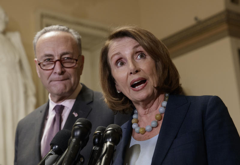 FILE - In this March 13, 2017 file photo, House Minority Leader Nancy Pelosi of Calif., accompanied by Senate Minority Leader Charles Schumer of N.Y., speaks to reporters on Capitol Hill in Washington. Democrats are responding to President Donald Trump's threats to deny payments to health insurers under the Affordable Care Act with a demand that it be addressed in talks on a government-wide spending bill that is due at the end on the month.  (AP Photo/J. Scott Applewhite, File)